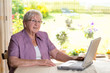 female senior is using computer