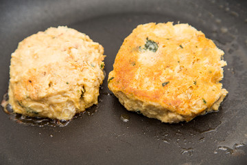Raw and Browned Crab Cakes in Pan