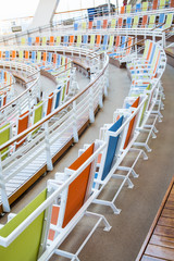 Rows of Colorful Canvas Chairs Curving Around an Arena