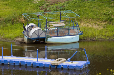 Old river pontoon boat