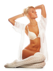 sensual blond girl in white lingerie and socks
