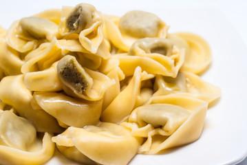 Italian ravioli  pasta on white plate