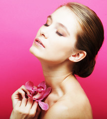 Beautiful happy woman with orchid flower