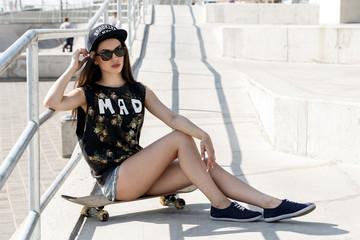 Beautiful girl with skateboard