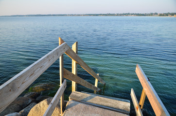 Wooden staircase to the water