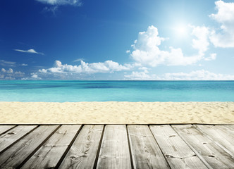 tropical beach and wooden platform