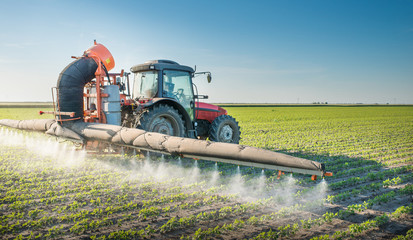 tractor spraying pesticides