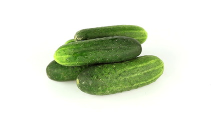 Cucumbers rotate on a white background loop
