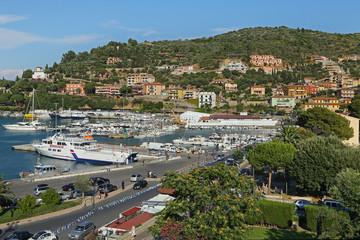 """Boats in the small harbor of """"Porto Santo Stefano"""""""
