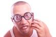 Satisfied nerd in eyeglasses calls by mobile phone