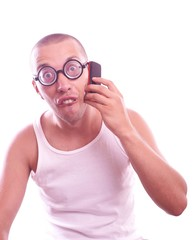 Satisfied nerd in eyeglasses calls by mobile phone