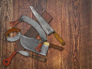 vintage kitchen knives  collage over old wood