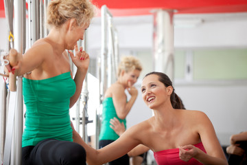 Women chatting in the gym after training