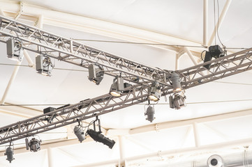 bright lighting rig inside a large marquee venue