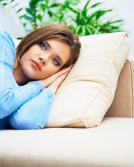 Relaxing young woman sofa lying.