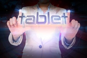 Businesswoman presenting the word tablet