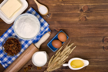 Baking ingredients on wooden table background with copy space