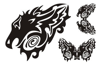 Tribal dragon head and twirled dragons symbols