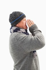 Sick mature man blowing his nose