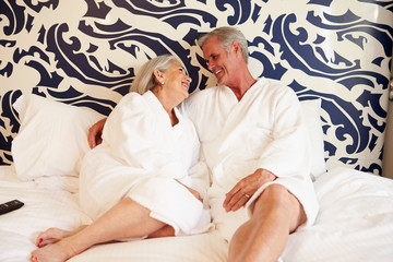 Senior Couple Relaxing In Hotel Room
