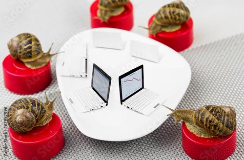 Leinwandbild Motiv snail business meeting metaphor with bad results