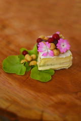 Swiss camambert with nuts and salad on the wooden circle