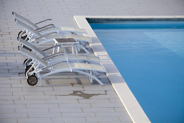 Deckchairs poolside