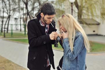Teenage couple smoking