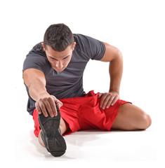 Hombre atleta deportista estirando músculos,calentamiento.