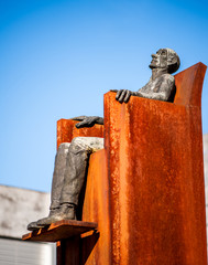 Monument man sitting in a chair in Vaduz