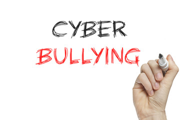 Hand writing cyber bullying