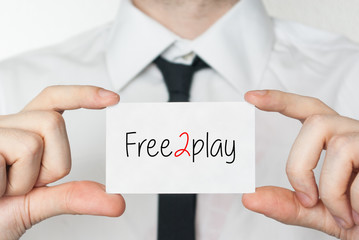 Free2play. Businessman holding business card