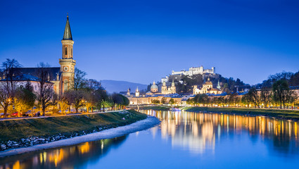 Salzburg skyline with river Salzach during blue hour, Austria