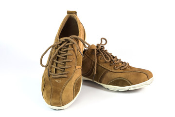 brown suede sports shoes on white background