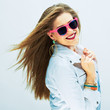 Fashion portrait of young model . Sunglasses pink