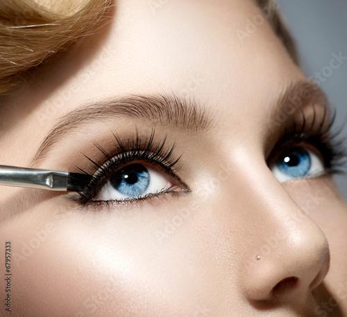 Leinwandbild Motiv Makeup Applying closeup. Beauty Girl with Perfect Skin