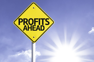 Profits Ahead road sign with sun background