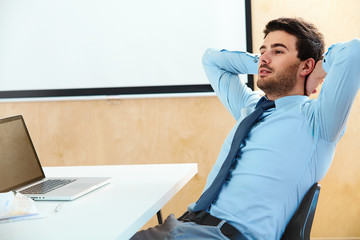 Portrait of a relaxed businessman sitting in a  office