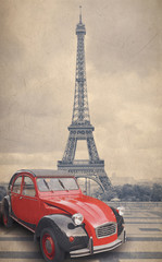 Eiffel Tower and red car with retro vintage style filter effect. © cranach