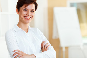 Portrait of happy young business woman in  office