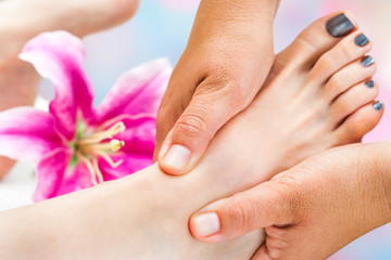 Reflexologist working on female foot