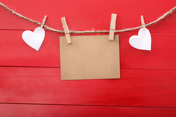 Blank message card and felt hearts with clothespins