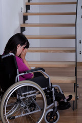 Disabled woman in front of stairs