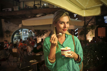 beautiful girl who is eating an ice cream