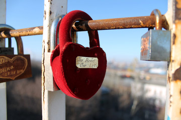 A love lock hanging on a bridge