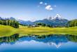 Leinwandbild Motiv Idyllic summer landscape with mountain lake and Alps
