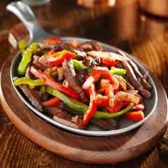 mexican food - beef fajitas and bell peppers