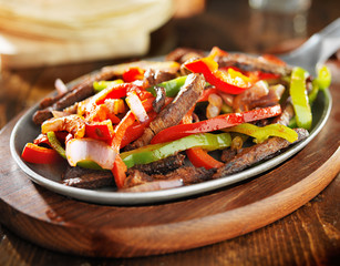 mexican beef fajitas in iron skillet