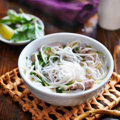 hot bowl of pho with beef and rice noodles