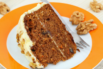 Carrot cake with walnuts and marzipan icing, close up